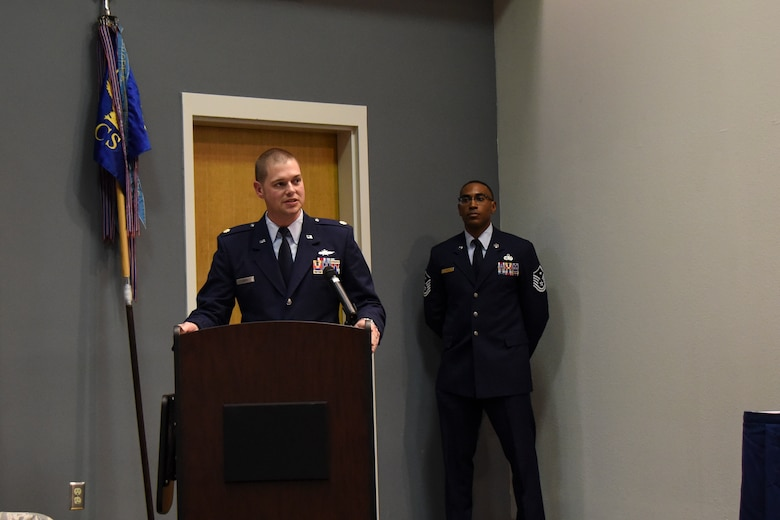 U.S. Air Force Maj. David Coté, 17th Communications Squadron commander, speaks to the crowd during the change of command ceremony in the Event Center on Goodfellow Air Force Base, Texas, May 10, 2018. Coté thanked those in attendance including his family as well as members of the 17th CS, and spoke on his gratitude towards them as their new commander. (U.S. Air Force photo by Airman 1st Class Zachary Chapman/Released)