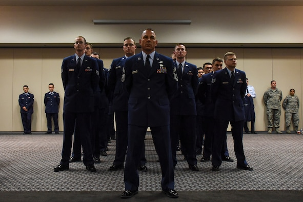 U.S. Air Force Chief Master Sgt. Frank Lubas, 17th Communications Squadron superintendent, stands with members of 17th CS during the change of command ceremony in the Event Center on Goodfellow Air Force Base, Texas, May 10, 2018. The 17th CS provides cyber operations and support to enable the 17th Training Wing to produce the best Intelligence, Surveillance, and Reconnaissance professionals and firefighters in the world. (U.S. Air Force photo by Airman 1st Class Zachary Chapman/Released)