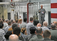 """Brig. Gen. Richard Kemble, 94th Airlift Wing commander, addresses Airmen during his first commander's call held last weekend. """"I need a warrior in each of you,"""" said the commander. """"I need your A-game each and every day, and I need you to come in with passion and with a warrior ethos!""""  (U.S. Air Force photo/Staff Sgt. Miles Wilson)"""