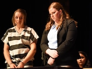 A student performer receives a 15 year jail sentence for causing a simulated vehicle accident during Douglas High School's Freshman Impact in Box Elder S.D., May 9, 2018. This event teaches young adults about the dangers of driving under the influence and distracted driving so they can make better decisions while behind the wheel. (U.S.  Air Force photo by Airman 1st Class Thomas Karol)