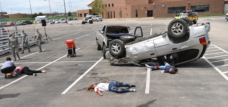 A scene of a simulated vehicle accident is set up during Freshman Impact at Douglas High School, Box Elder S.D., May 9, 2018. This event teaches young adults about the dangers of driving under the influence and distracted driving so they can make better decisions behind the wheel. (U.S.  Air Force photo by Airman 1st Class Thomas Karol)