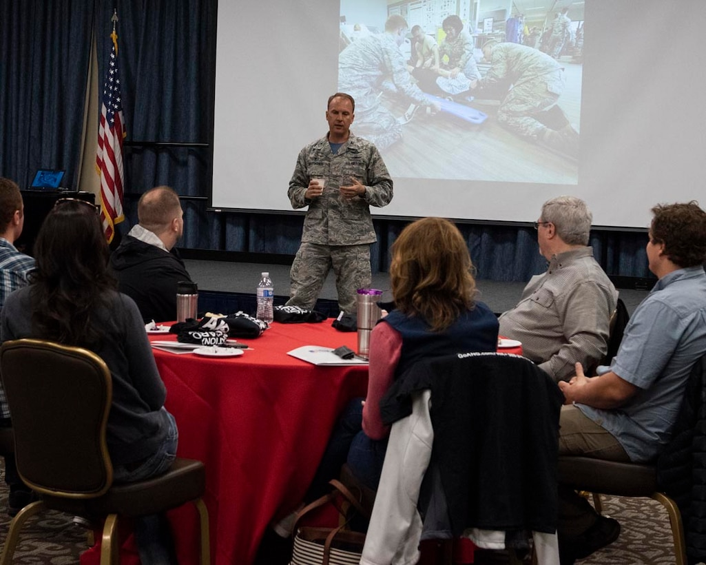 """Col. Johan Deutscher, commander, 141st Air Refueling Wing, addresses a group of civilian employers attending an Employer Support of the Guard and Reserve """"Boss Lift"""" event May 5, 2018 at Fairchild Air Force Base, Wash. Airmen from the 141st ARW have the opportunity to nominate their civilian employers to participate in various ESGR events throughout the year. ESGR aims to encourage cooperation between service members and their civilian employers and to educate them on the mission of the 141st ARW. (U.S. Air National Guard photo by Staff Sgt. Rose M. Lust)"""