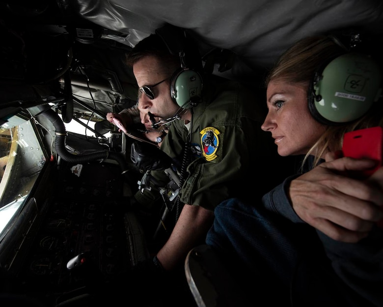 """Employers Tonya Murray and Chandra Fox watch as Master Sgt. Thomas Nance, a 116th Air Refueling Squadron boom operator, refuels an F-15C Eagle from the 173rd Fighter Wing in Klamath Falls, Ore. May 5, 2018 over southern Oregon. Murray and Fox were two of the 20 employers to be nominated for the familiarization flight during the ESGR """"Boss Lift."""" (U.S. Air National Guard photo by Staff Sgt. Rose M. Lust)"""