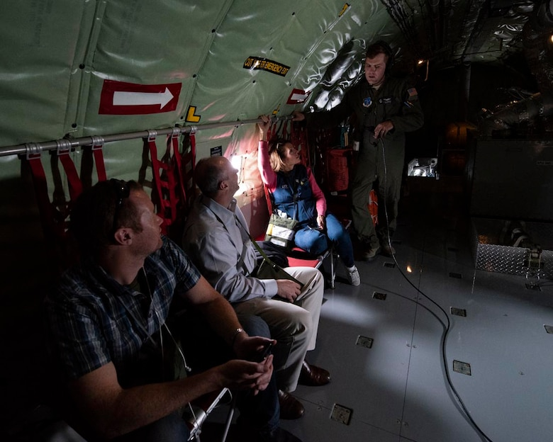 """Capt. Brendon Townshend, a pilot with the 141st Air Refueling Wing, chats with some civilian employers aboard a KC-135 Stratotanker during an Employer Support of the Guard and Reserve """"Boss Lift"""" event May 5, 2018 over central Oregon. Airmen from the 141st ARW have the opportunity to nominate their civilian employers to participate in various ESGR events throughout the year to encourage cooperation between service members and their civilian employers and to educate them on the mission of the 141st ARW. (U.S. Air National Guard photo by Staff Sgt. Rose M. Lust)"""