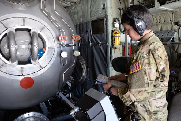 Staff Sgt. Annie Lepillez, a 731st Airlift Squadron loadmaster, reads over a checklist before a training mission during the annual wildland firefighting training and certification sponsored by the U.S.D Department of Agriculture Forest Service at McClellan Reload Base, California, April 26, 2018.