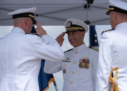 180511-N-LY160-0202 PEARL HARBOR (May 11, 2018) - Cmdr. Kevin Moller, left, reports his relief to Capt. Robert Roncska, commander of Submarine Squadron Seven, middle, during the Los Angeles-class fast-attack submarine USS Jefferson City (SSN 759) change of command ceremony at the USS Bowfin Submarine Museum and Park in Pearl Harbor, Hawaii, May 11. Cmdr. Steven Dawley relieved Moller as the 14th commanding officer of Jefferson City. (U.S. Navy photo by Mass Communication Specialist 2nd Class Michael Lee/Released)