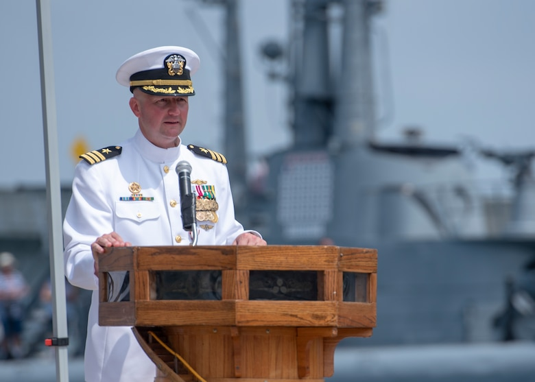 180511-N-LY160-0165 PEARL HARBOR (May 11, 2018) - Cmdr. Kevin Moller, commanding officer of Los Angeles-class fast-attack submarine USS Jefferson City (SSN 759), addresses guests during a change of command ceremony at the USS Bowfin Submarine Museum and Park in Pearl Harbor, Hawaii, May 11. Cmdr. Steven Dawley relieved Moller as the 14th commanding officer of Jefferson City. (U.S. Navy photo by Mass Communication Specialist 2nd Class Michael Lee/Released)