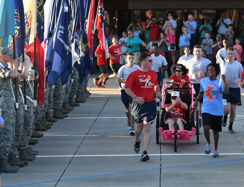 U.S. Air Force Col. C. Mike Smith, 81st Training Wing vice commander, participates in the torch run during the Special Olympics Mississippi 2018 Summer Games opening ceremony at the Training Levitow Training Support Facility drill pad at Keesler Air Force Base, Mississippi, May 11, 2018. Founded in 1968, Special Olympics hosts sporting events around the world for people of all ages with special needs to include more than 700 athletes from Mississippi. (U.S. Air Force photo by Kemberly Groue)
