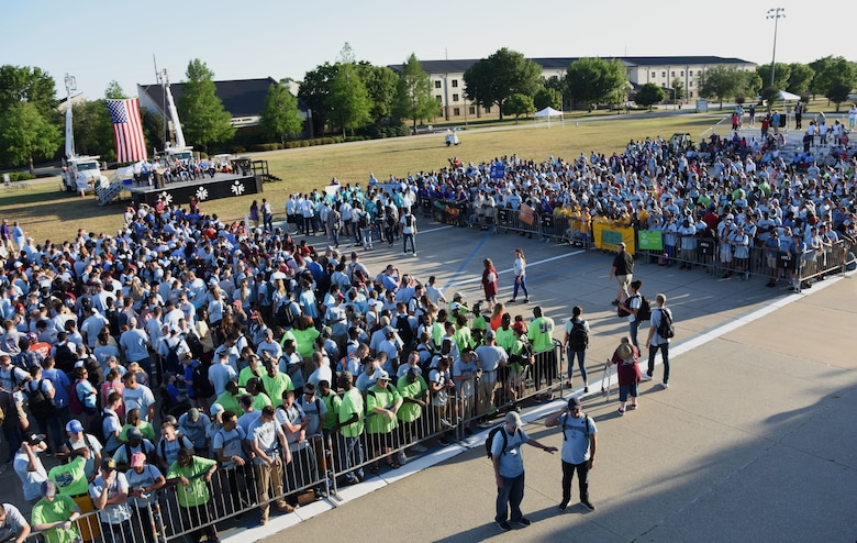 Athletes and Airmen sponsors fill the drill pad during the Special Olympics Mississippi 2018 Summer Games opening ceremony at the Training Levitow Training Support Facility drill pad at Keesler Air Force Base, Mississippi, May 11, 2018. Founded in 1968, Special Olympics hosts sporting events around the world for people of all ages with special needs to include more than 700 athletes from Mississippi. (U.S. Air Force photo by Kemberly Groue)