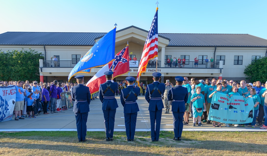 Keesler Honor Guard members present the colors during the Special Olympics Mississippi 2018 Summer Games opening ceremonies at the Levitow Training Support Facility drill pad May 11, 2018, on Keesler Air Force Base, Miss. Founded in 1968, Special Olympics hosts sporting events around the world for people of all ages with special needs to include more than 700 athletes from Mississippi. (U.S. Air Force photo by Andre' Askew)