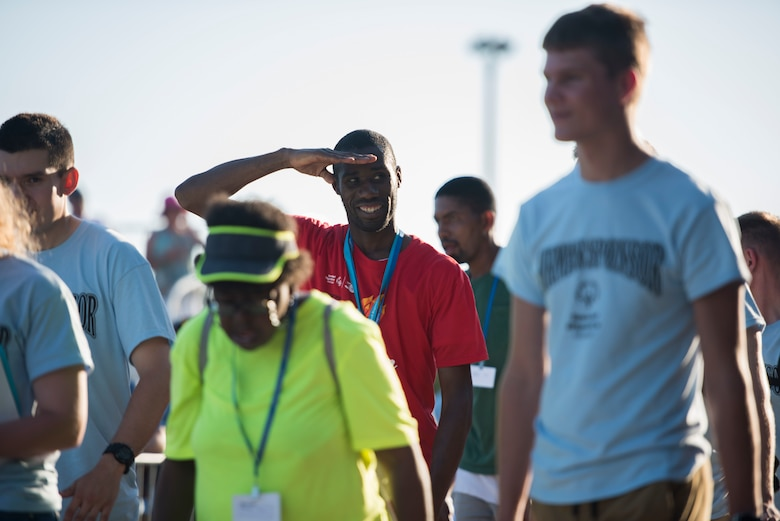 A Special Olympics Mississippi athlete renders a salute during the SOMS 2018 Summer Games opening ceremony at the Levitow Training Support Facility drill pad at Keesler Air Force Base, Mississippi, May 11, 2018. Founded in 1968, Special Olympics hosts sporting events around the world for people of all ages with special needs to include more than 700 athletes from Mississippi. (U.S. Air Force photo by Senior Airman Travis Beihl)