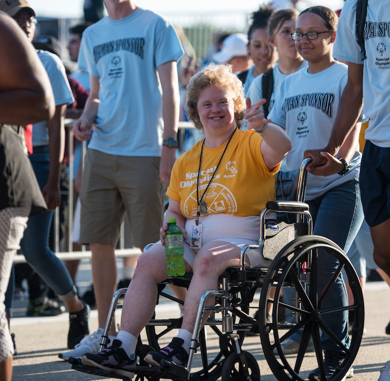 A Special Olympics Mississippi athlete waves during the SOMS 2018 Summer Games opening ceremony at the Levitow Training Support Facility drill pad at Keesler Air Force Base, Mississippi, May 11, 2018. Founded in 1968, Special Olympics hosts sporting events around the world for people of all ages with special needs to include more than 700 athletes from Mississippi. (U.S. Air Force photo by Senior Airman Travis Beihl)