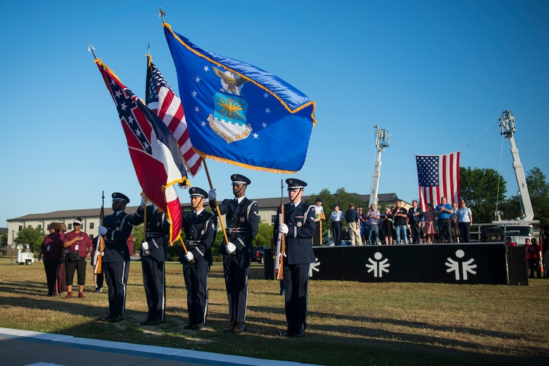 Keesler Base Honor Guard presents the colors during the Special Olympics Mississippi 2018 Summer Games opening ceremony at the Levitow Training Support Facility drill pad at Keesler Air Force Base, Mississippi, May 11, 2018. Founded in 1968, Special Olympics hosts sporting events around the world for people of all ages with special needs to include more than 700 athletes from Mississippi. (U.S. Air Force photo by Senior Airman Travis Beihl)