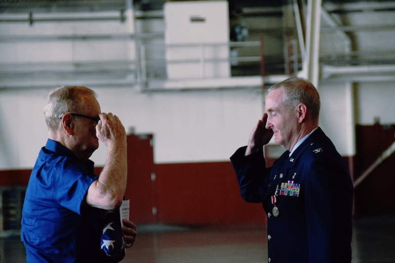 Col. Michael Nelson, 433rd Medical Squadron, salutes his father, Larry Nelson, after he gives him the American flag the 433rd Honor Guard presented the retiring colonel at his retirement ceremony May 5, 2018 at Joint Base San Antonio, Texas.  (U.S. Air Force photo by Tech. Sgt. Carlos J. Trevino)