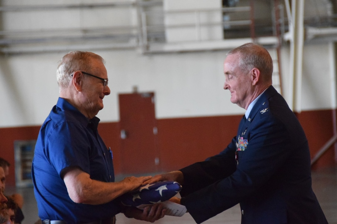 Col. Michael Nelson, 433rd Medical Squadron, pays tribute to his father, Larry Nelson, by giving him the American flag the 433rd Honor Guard had just presented to him at his retirement ceremony May 5, 2018 at Joint Base San Antonio, Texas.  (U.S. Air Force photo by Tech. Sgt. Carlos J. Trevino)