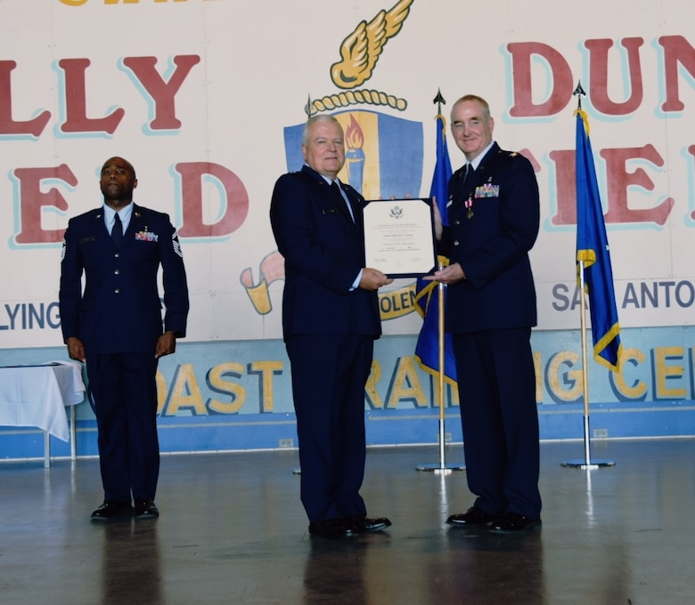 Brig. Gen. John C. Fobian (Ret.), a former 433rd Airlift Wing commander, presents Col. Michael D. Nelson(right), 433rd Medical Squadron commander, the certificate of retirement in a ceremony May 5, 2018 at Joint Base San Antonio, Texas. Nelson's career in the United States Air Force began as an enlisted member in January 1987. (U.S. Air Force photo by Tech. Sgt. Carlos J. Trevino)