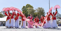Students and faculty perform the Korean Fan Dance during the Defense Language Institute Foreign Language Center Language Day at the Presideo of Monterey, California, May 11, 2018. This was one of 48 performances that took place during Language Day that showcased various cultures and traditions throughout the world.