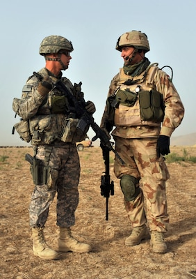 Maj. James Eriksen, left, commander of Operational Mentor and Liasion Team (OMLT) 9.1, talks with a Hungarian army counterpart while on duty in Afghanistan, circa 2009. The ONG and Hungarian military partnered for several rotations in the early 2010s to train the Afghan National Army.