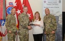 thress soldier awarding a civilian