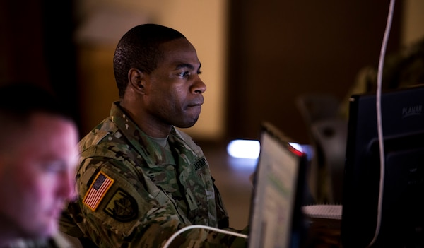 U.S. Army Chief Warrant Officer 3 Clinton Store studies course content during the training week of  Cyber Shield 18 at Camp Atterbury Indiana, May 8, 2018. Cyber Shield gathers Soldiers, Airmen and civilian cyber security professionals to train and conduct exercises that prepare participants for roles in the National Guard's Defensive Cyber Operations Elements.