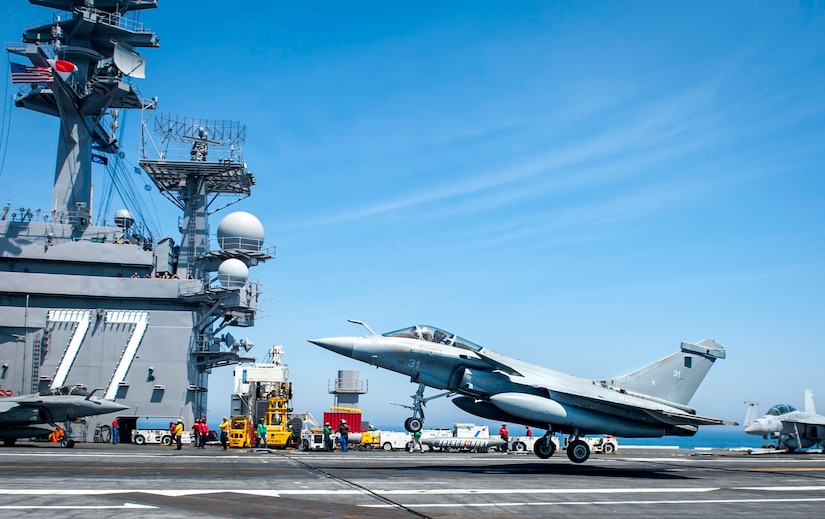 A French navy Rafale aircraft lands on the aircraft carrier USS George H.W. Bush in the Atlantic Ocean.