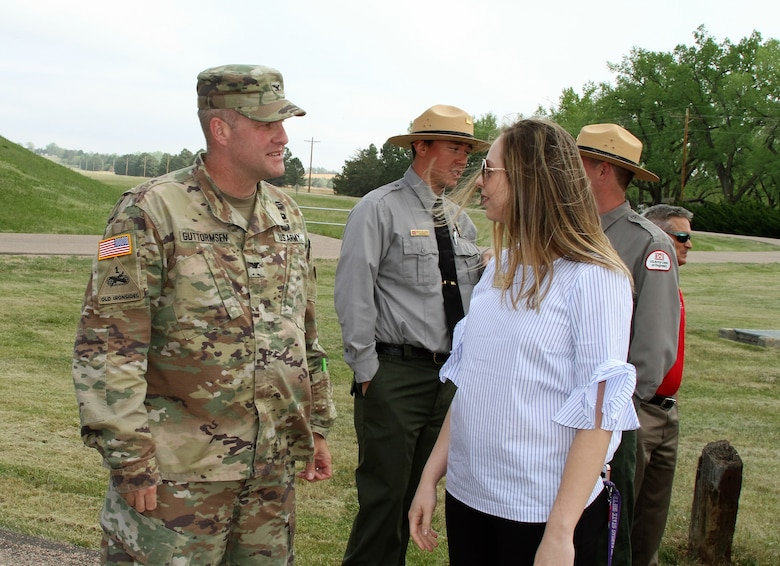 Col. Douglas Guttormsen speaks with Kristin Conley, representative for Sen. Jerry Moran, with his Manhattan, Kansas office, prior to the ribbon cutting ceremony May 11, 2018. Conley had a prime interest in the agricultural benefits farms in Kansas gain from the purpose of irrigation enhanced by repairs to the dam.