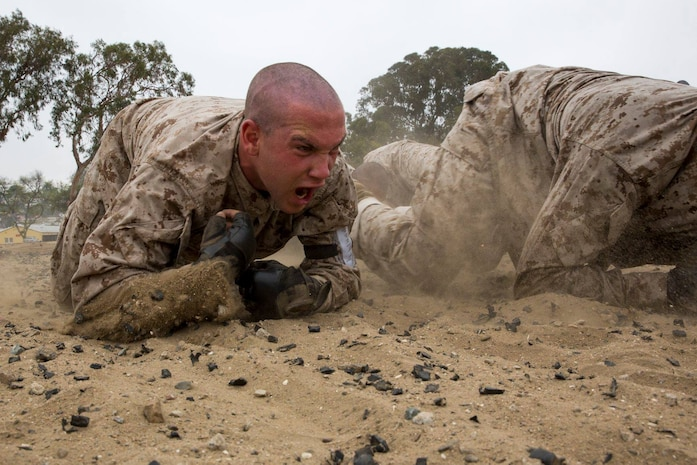 You voted and we listened! A recruit with Golf Company, 2nd Recruit Training Battalion, crawls during a combat conditioning exercise at Marine Corps Recruit Depot San Diego, May 9.