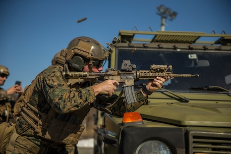 A U.S. Marine with 1st Platoon, 1st Reconnaissance Battalion, 1st Marine Division, conducts barrier shooting drills during Exercise Platinum Ren at Fort Trondennes, Harstad, Norway, May 10, 2018.