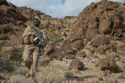 U.S. Marine Corps Lance Cpl. Peyton Ross, an infantryman with 3rd Light Armored Reconnaissance Battalion, 1st Marine Division, conducts a foot patrol during a Marine Corps Combat Readiness Evaluation (MCCRE) at Marine Corps Air Ground Combat Center, Twentynine Palms, Calif., March 12, 2018.
