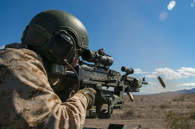 U.S. Marine Corps Cpl. Robert Moreno, a vehicle commander with 3rd Light Armored Reconnaissance Battalion, 1st Marine Division, fires a M240B machine gun from atop a Light Armored Vehicle during a Marine Corps Combat Readiness Evaluation (MCCRE) at Marine Corps Air Ground Combat Center, Twentynine Palms, Calif., March 15, 2018