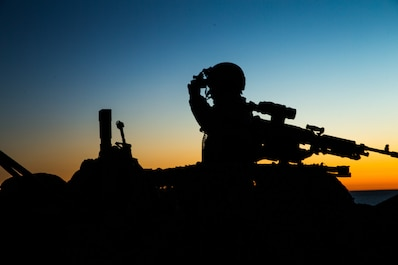 A Marine with 1st Light Armored Reconnaissance Battalion, 1st Marine Division adjusts his night vision as the sun set on Marine Corps Base Camp Pendleton, Calif., Feb. 20, 2018.