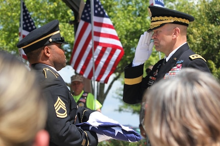 Lt. Gen. Jeffrey Buchanan (right) salutes as he is handed the folded U.S. flag by a member of the Fort Sam Houston Honor Guard May 11 at the memorial service for Army Maj. Donald G. Carr at the Fort Sam Houston National Cemetery. Buchanan is the commanding general of U.S. Army North (Fifth Army). Carr, a Green Beret, was declared missing in action after his OV-10A Bronco aircraft crashed July 6, 1971, during bad weather on a mission in Vietnam.