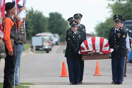 Members of the Fort Sam Houston Honor Guard carry the casket containing the remains of my Maj. Donald G. Carr to a burial service at the Fort Sam Houston National Cemetery May 11. Carr, a Green Beret, was declared missing in action after his OV-10A Bronco aircraft crashed July 6, 1971, during bad weather on a mission in Vietnam.