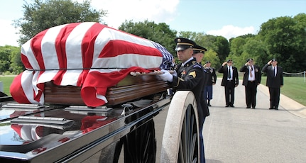Members of the Fort Sam Houston Honor Guard remove the casket containing the remains of Army Maj. Donald G. Carr from the caisson for a memorial service at the Fort Sam Houston National Cemetery May 11. The Special Forces officer was lost while on a forward air controller mission in 1971. Maj. Carr's remains were found in 2014 and verified in 2016. He was buried at Fort Sam Houston National Cemetery with full honors.