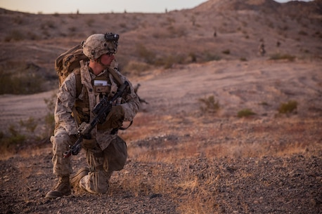 U.S. Marine Corps Cpl. Tanner Reihm, a squad leader with 3rd Battalion, 7th Marine Regiment, 1st Marine Division, provides security during a Marine Corps Combat Readiness Evaluation (MCCRE) at Marine Corps Air Ground Combat Center, Twentynine Palms, Calif., Nov. 28, 2017.