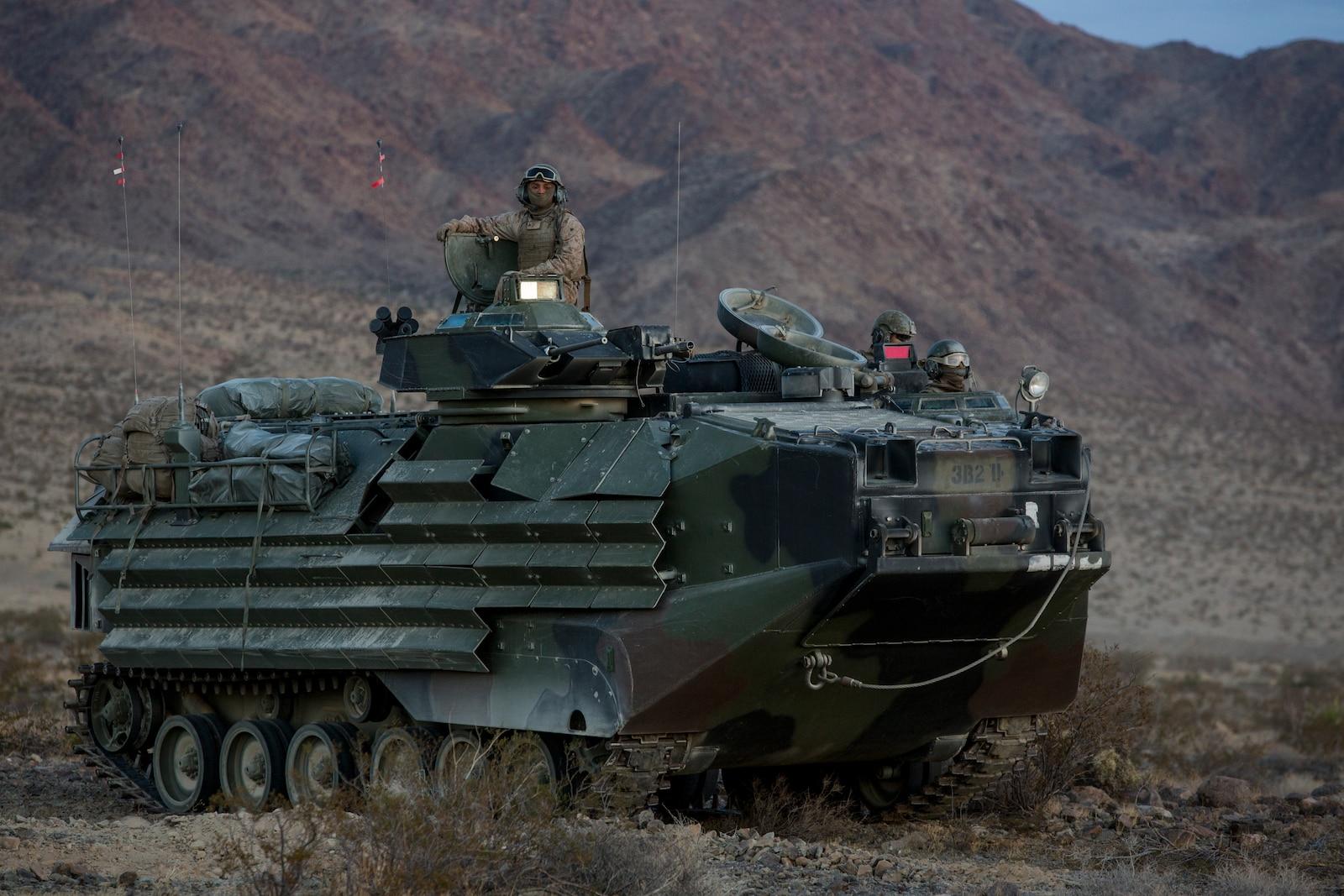 U.S. Marines with 3rd Battalion, 7th Marine Regiment, 1st Marine Division, utilize amphibious assault vehicles during a Marine Corps Combat Readiness Evaluation (MCCRE) at Marine Corps Air Ground Combat Center, Twentynine Palms, Calif., Nov. 29, 2017.