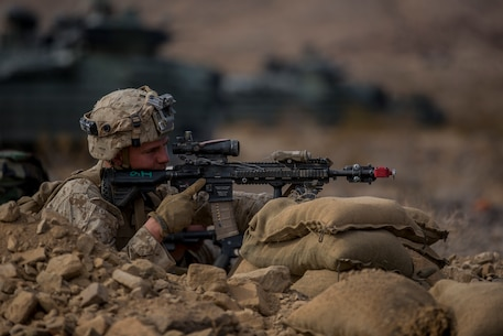 U.S. Marine Corps Lance Cpl. Jacob McLean, a rifleman with 3rd Battalion, 7th Marine Regiment, 1st Marine Division, engages the enemy during a Marine Corps Combat Readiness Evaluation (MCCRE) at Marine Corps Air Ground Combat Center, Twentynine Palms, Calif., Nov. 30, 2017.