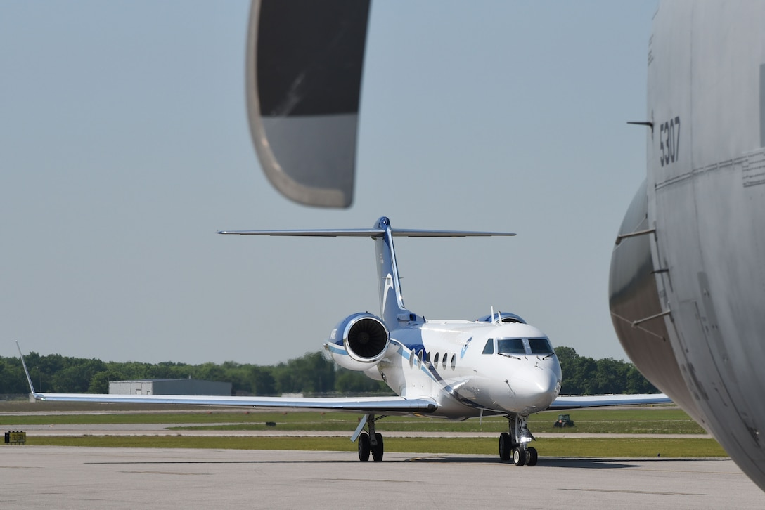 NOAA's G-IV aircraft taxis into its parking spot near the Air Force Reserve's WC-130J aircraft at the Montgomery Regional Airport, Montgomery, Alabama., May 10, 2018 during the Gulf Coast Hurricane Awareness Tour. NOAA has conducted the hurricane awareness tour for more than 35 years, alternating between the U.S. Gulf and Atlantic coasts. The tour is part of NOAA's hurricane hazard education campaign, coinciding with National Hurricane Preparedness Week.