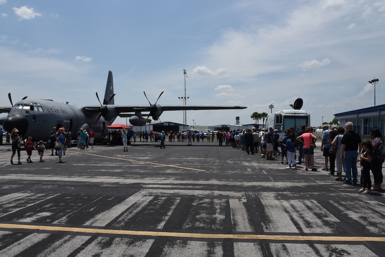 People line up at the Lakeland Linder Regional Airport, Lakeland, Florida May 11, 2018, to see the WC-130J aircraft used by the 53rd Weather Reconnaissance Squadron to collect weather data for the National Hurricane Center's forecasts. NOAA's National Weather Service and NHC has conducted the Hurricane Awareness Tour for more than 35 years; however, this is the fourth year the 53rd WRS has participated in all five stops of the awareness and preparedness event, which was in conjunction with National Hurricane Preparedness Week May 7-11, 2018. (U.S. Air Force photo/Maj. Marnee A.C. Losurdo)