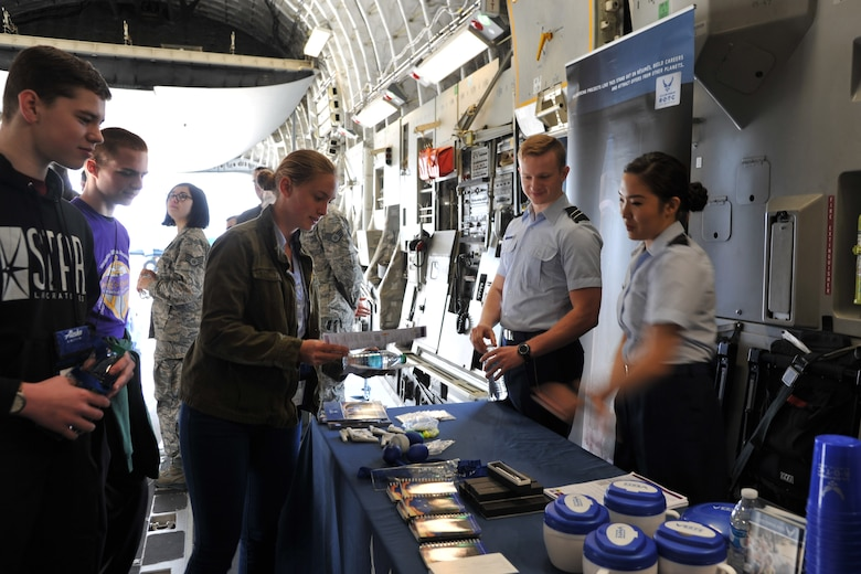Cadets from the Air Force Reserve Officer Training Corps Detachment 910 share information with teenage students visiting the C-17 Globemaster III static display during the Alaska Airlines Aviation Day event May 5, 2018 at Seattle-Tacoma International Airport.