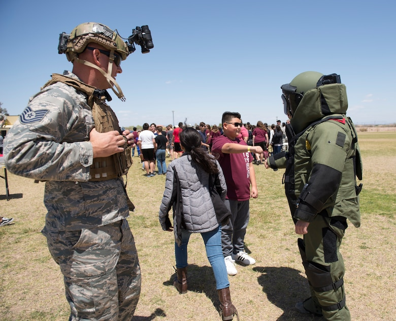 Members of the 56th Civil Engineer Squadron explosive ordnance disposal flight interact with students from L. Thomas Heck Middle School April 20, 2018, in Litchfield Park, Ariz. Together with the 56th Security Forces Squadron, Luke Airmen visited the school to thank them for their efforts in providing care packages for deployed service members and to immerse them, for a brief period of time, in military customs. (U.S. Air Force photo by Senior Airman Ridge Shan)