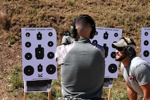 U.S. Air Force Airman Josten Lacey, 17th Security Forces Squadron defender, shoots under the instruction of The Shooting Institute chief executive officer, Jared Hudson, during the Special Weapons and Tactics and Close Quarters Combat training at the Goodfellow Air Force Base shooting range in San Angelo, Texas, May 9, 2018. Students learned how to operate their weapons inside buildings. (U.S. Air Force photo by Airman 1st Class Seraiah Hines/Released)