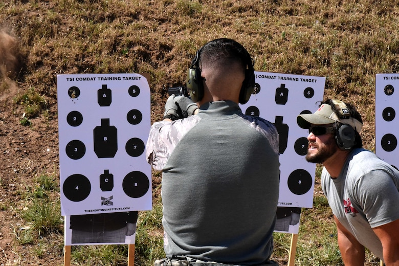 U.S. Air Force Airman Josten Lacey, 17th Security Forces Squadron operator, shoots under the instruction of The Shooting Institute chief executive officer, Jared Hudson, during the Special Weapons and Tactics and Close Quarters Combat training at the Goodfellow Air Force Base shooting range in San Angelo, Texas, May 9, 2018. Students learned how to operate their weapons inside buildings. (U.S. Air Force photo by Airman 1st Class Seraiah Hines/Released)
