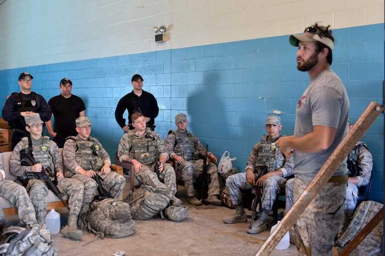The Shooting Institute chief executive officer, Jared Hudson, briefs Goodfellow Air Force Base and Special Weapons and Tactics team members before performing maneuvers during the SWAT and Close Quarters Combat training at the Eldorado Air Force Station in Eldorado, Texas, May 10, 2018. The students learned the basics of approach, breaching, deliberate vs. dynamic movement, threat identification and how to use pistols and rifles in CQC environments. (U.S. Air Force photo by Senior Airman Randall Moose/Released)