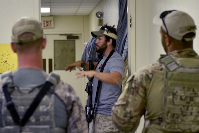 The Shooting Institute chief executive officer, Jared Hudson, demonstrates close quarters combat maneuvers during the Special Weapons and Tactics and Close Quarters Combat training at the Eldorado Air Force Station in Eldorado, Texas, May 10, 2018. The Shooting Institute, a company made up of former Navy SEALS, special operations and law enforcement individuals that travels around providing expert level firearms and tactical training provided the training. (U.S. Air Force photo by Senior Airman Randall Moose/Released)