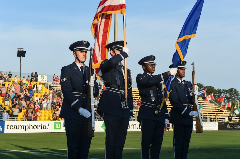 Members of the Joint Base Charleston Honor Guard present the colors during the national anthem for the Charleston Battery Military Appreciation Night at MUSC Health Stadium on Daniel Island in Charleston, S.C., May 12, 2018. The National Anthem was performed by the Iron Horse Choir from Philip Simmons Elementary School in Wando, S.C.