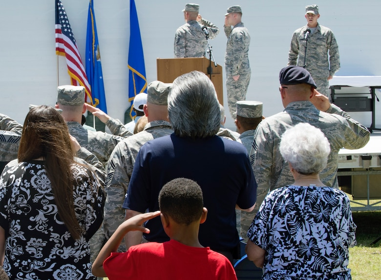 Attendees honor the U.S. flag as the national anthem is sung at the Joint Base San Antonio Airman Leadership School naming ceremony at JBSA-Lackland, Texas, May 11, 2018. The school was named in honor of Staff Sgt. Cierra Rogers, an alumnus, who died May 20, 2016, from injuries sustained after saving a family from a burning building April 29, 2016. (U.S. Air Force photo by Tech. Sgt. R.J. Biermann)