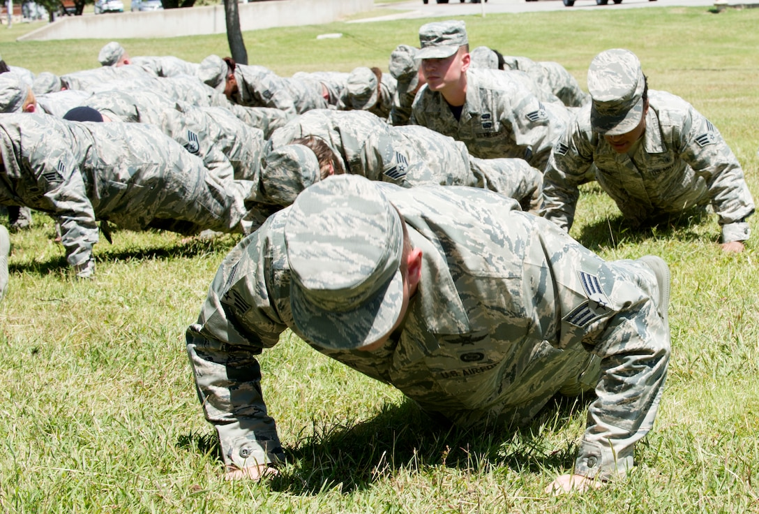 Airmen perform memorial pushups during the Joint Base San Antonio Airman Leadership School naming ceremony at JBSA-Lackland, Texas, May 11, 2018. The school was named in honor of Staff Sgt. Cierra Rogers, an alumnus, who died May 20, 2016 from injuries sustained after saving a family from a burning building April 29, 2016. (U.S. Air Force photo by Tech. Sgt. R.J. Biermann)