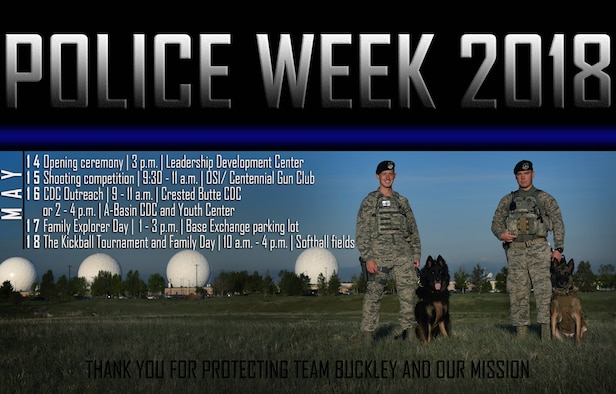 From left to right, Senior Airman Victor Daniels and Staff Sgt. Adam Robinson, both military working dog handlers assigned to the 460th Security Forces Squadron, pose for a photo with their military working dogs, Aries and Ari, respectively, in front of the radomes on Buckley Air Force Base, Colo., May 11, 2018.