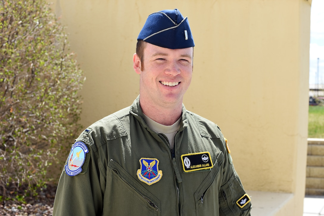 "1st Lt. Alexander ""Ara"" Allard, 490th Missile Squadron missile squadron safety officer and assistant flight commander, poses at the 341st Missile Wing headquarters building after returning from missile field duty on May 8, 2018, at Malmstrom Air Force Base, Mont. Allard is participating in a pilot program that broadens safety knowledge and practices in intercontinental ballistic missile operations. (U.S. Air Force photo by Kiersten McCutchan)"